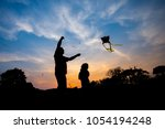 silhouette father and his... | Shutterstock . vector #1054194248