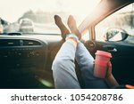 woman is holding cup of coffee... | Shutterstock . vector #1054208786