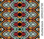 ikat geometric folklore... | Shutterstock .eps vector #1054213730