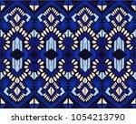 ikat geometric folklore... | Shutterstock .eps vector #1054213790