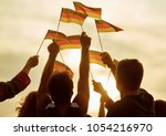 people hold german flags.... | Shutterstock . vector #1054216970