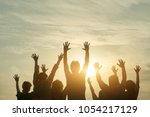 people silhouette at sunset.... | Shutterstock . vector #1054217129