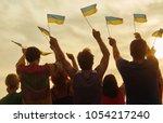 ukrainian patriots with small... | Shutterstock . vector #1054217240