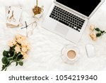 female workspace with laptop ... | Shutterstock . vector #1054219340