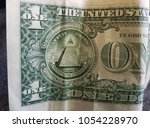 bent and wrinkled one dollar...   Shutterstock . vector #1054228970