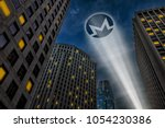 Monero cryptocurrency, anonymous payment open source privacy payment coin, super hero concept visualization, beam of light projecting Monero symbol logo on the dark night sky between city skyscrapers