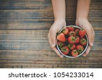 hand of people holding... | Shutterstock . vector #1054233014