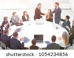 business partners shake hands... | Shutterstock . vector #1054234856