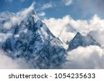 majestical scene with mountains ... | Shutterstock . vector #1054235633