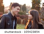 happy smiling couple against... | Shutterstock . vector #105423854