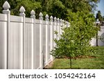 solid privacy vinyl fence | Shutterstock . vector #1054242164