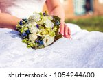 wedding bouquet of white yellow ... | Shutterstock . vector #1054244600