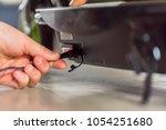closeup day view teen hand plug ... | Shutterstock . vector #1054251680