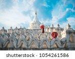Novices under umbrellas at historic temple, Mingun, Mandalay, Myanmar