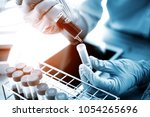 technician of health with test... | Shutterstock . vector #1054265696