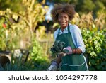 african american woman holding... | Shutterstock . vector #1054297778