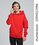 handsome teenage boy with... | Shutterstock . vector #1054311986