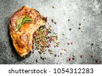 the pork steak with spices. on... | Shutterstock . vector #1054312283