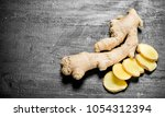 fresh ginger. on the black... | Shutterstock . vector #1054312394