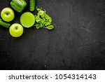 greeny vegetable smoothie in... | Shutterstock . vector #1054314143