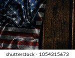 usa flag on a wood surface | Shutterstock . vector #1054315673