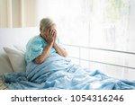 asian depressed elderly woman... | Shutterstock . vector #1054316246