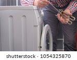 washing machine repair.... | Shutterstock . vector #1054325870
