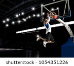 basketball player in action in... | Shutterstock . vector #1054351226