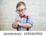 happy boy standing with a... | Shutterstock . vector #1054365503