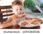 little kid boy having healthy... | Shutterstock . vector #1054383038