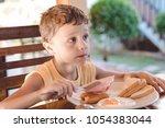 little kid boy having healthy... | Shutterstock . vector #1054383044