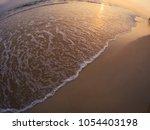 sunset light over sandy beach... | Shutterstock . vector #1054403198