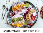 3 smoothie bowls with colorful... | Shutterstock . vector #1054404110