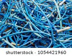 tangled lump or pile of blue... | Shutterstock . vector #1054421960