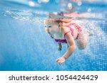 little baby  girl swimming... | Shutterstock . vector #1054424429