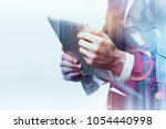 businessman using tablet on... | Shutterstock . vector #1054440998
