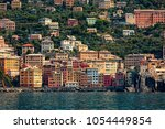 seaside view of colorful houses ... | Shutterstock . vector #1054449854