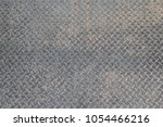 seamless sheet of steel aluminum or nickel tread plate. Dirty grunge background pattern with dirt and grime. Worn piece of metal. - stock photo