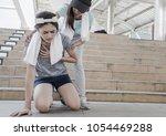 sport women is clutching her... | Shutterstock . vector #1054469288