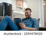 Stock photo young man listening to music 1054478420