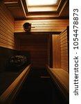 sauna  wooden interior baths ... | Shutterstock . vector #1054478873
