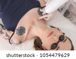 cosmetologist with patient and... | Shutterstock . vector #1054479629