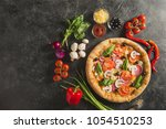 flat lay with italian pizza and ...   Shutterstock . vector #1054510253