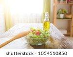 full bowl of fresh green salad... | Shutterstock . vector #1054510850