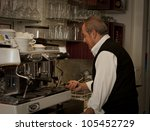 italian man making espresso in... | Shutterstock . vector #105452729