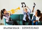 Group Of People Enjoying Music...