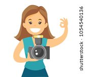 female photographer taking a... | Shutterstock .eps vector #1054540136