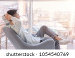 young man resting in armchair.... | Shutterstock . vector #1054540769