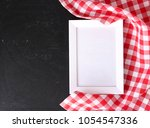 red checkered cloth on... | Shutterstock . vector #1054547336