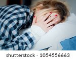 young woman crying in bed after ... | Shutterstock . vector #1054556663